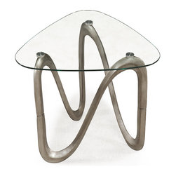 Magnussen Home Furnishings - Spano Shaped Tempered Glass and Metal End Table - Graceful curves,fluid materials and natural forms prevail in the surprisingly organic Spano. This table is finished in brushed pewter with a 10mm tempered glass top.