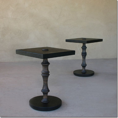 Modern Pedestal End Table - This handsome pedestal table is the perfect contrast of material and texture in the forever-modern color; black. The top and base surface are wrapped in durable pebble-embossed leather, while the turned Margosa wood stem and top finial are finished in a pale charcoal wiping stain with a waxed finish. Inspired by naturally grayed Teak, the finish is perfect for someone who likes the depth of a rich dark color, but still wants to see a natural wood grain.