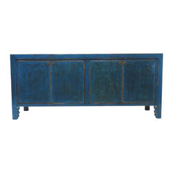 Andrea Blue 4 Door Tall Sideboard - Our collection of sideboards are built of beautiful elm wood reclaimed from buildings and furniture pieces that graced the eclectic Qing dynasty. Each piece is meticulously hand built and finished by time-honored craftsman utilizing over 120 different processes. A gorgeous addition to your living room, stunning under your flat panel television, or for extra storage, this sideboard is sure to make a statement.