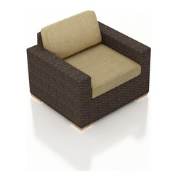 Harmonia Living - Arden Modern Patio Club Chair, Heather Beige Cushions - The Arden Outdoor Modern Club Chair with Tan  Sunbrella® Cushions (SKU HL-ARD-CC-CH-HB) brings a cozy, rustic appeal to modern outdoor furniture. Its beautiful wicker is finished with a weathered Chestnut finish and is made from High-Density Polyethylene (HDPE), which ensures that the wicker will neither fade nor peel in regular sun exposure. What makes the Arden Collection unique is its high arms, modern style, and extra-plush cushions, all with a hint of classic traditional looks. Its teak feet elevate the seats in an attractive fashion that accent the wicker. The cushions are made from Sunbrella fabric, which is available in a large assortment of shades to give your Arden set the look that fits right into your outdoor space.