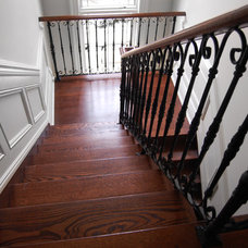Traditional Staircase by Deluxe Stair & Railing Ltd