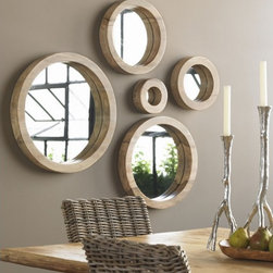 Porthole Mirror Collection by VivaTerra - Five mismatched sizes of naturally aged sheesham wood has to look good over whatever the mirrors reflect.