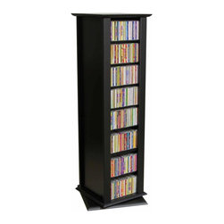 Venture Horizon - 2 Sided Revolving Multi-Media Tower (Oak) - Finish: OakRotates 360°. Huge storage capacity. Organizes all media. 8 Shelves. Constructed from durable, stain resistant and laminated wood composites that includes MDF. Made in the USA. Pictured in Black finish. Assembly required. Media storage capacity:. CD's : 416. DVD's : 216. Blu-ray's: 276. VHS tapes: 120. Disney tapes: 90. Audio cassettes: 400+. Weight: 55 lbs.. Shelf depth: 6 in.. 15 in. W x 14.5 in. D x 50.75 in. HOrganize an entire media collection. These 4 sided beauties will brighten up any room. Because they rotate a full 360°, you will never have to strain your neck locating your favorite CD, DVD, video or cassette. There are 5 models from which to choose so identifying the perfect match should be easy. Nearly all the shelves are adjustable so even odd sized media like Disney Tapes can be accommodated. Constructed from durable melamine laminated particle board these towers are stain resistant and easy to clean. The front panels and top/bottom panels on Models: 2021, 2022, 2381, 2391 and 2392 are gently molded and stylishly contoured to add real value. NEW! We just added a 2 sided Revolving Media Tower available in 2 sizes and 4 colors.