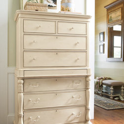 Universal Furniture - Paula Deen Tall Chest in Linen - The Universal Furniture Paula Deen Tall Chest, like all Paula Deen furnishings, has a casual, homey feel while elegant carvings lend stylishness. Seven drawers equal loads of storage space and the bottom of the lowest drawer is made of cedar; the perfect place for your best woolen items.  Majestic in this linen finish, a semi-hidden jewelry drawer offers peace of mind when putting away your valuables.  This tall chest is composed of selected hardwoods with birch veneers.