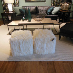 Ethan Allen's Ottoman Empire - Are these not just the cutest things? These Faux Fur Poufs are3 available in Ivory and Teal with matching pillows. Only at Ethan Allen.