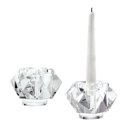 Lazy Susan - Faceted Star Crystal Candleholders - Small Set of 2 - This faceted star candleholder is formed by hand cutting sharp angular pieces of high quality crystal around a solid central column. The crystal shimmers and dances when the candle is light creating ambience and the shape angles play with the reflections. Suitable for a tea light or a taper candle. Set of 2.