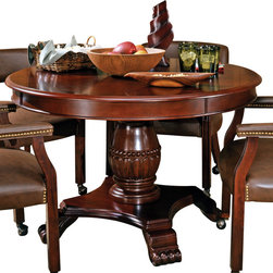 Steve Silver Furniture - Steve Silver Tournament Game Table in Cherry - The Classic Cherry Gaming Table Set has an attractive Cherry finish that will make a lovely addition to your home bar, billiards room or game room. Features include highly detailed woodworking and intricate carvings. Each of the matching chairs features detailed craftsmanship, casters which provide mobility, comfortable padded seats and backs that have decorative nail head trim and are upholstered in a durable leather that is easily cleaned. The Game table top includes poker chip and drink holders with an upholstered top for playing the ultimate games.