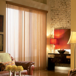 Vertical Wood Blinds - Vertical Blinds are versatile and can be customized to suit any space. They are commonly used in large windows or for sliding glass doors.