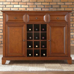 Crosley Newport Buffet Server with Wine Storage - Make entertaining stylish and convenient with this Newport Buffet Server with Wine Storage. Constructed of solid hardwood and wood veneers this beautiful cabinet features raised panel doors with a hand-rubbed satin finish in a variety of shades. Two large cabinet doors open to reveal adjustable shelves and three deep drawers hold all kinds of stuff. The center section proudly displays 12 bottles of wine. Brushed metal hardware and adjustable balancing levers in the legs are quality touches. Assembles easily. Never before has such elegant furniture been so helpful.About Crosley FurnitureIn 1920 Powel Crosley founded the company that pioneered radio broadcasting and mass market manufacturing around the world starting with a simple radio meticulously crafted with obsessive detail and accuracy and a measure of consideration for the wallet. These high ideals have served the company well for over 90 years and they live on in the newest addition to the family. Crosley Furniture sets a new standard for innovation function and meticulous craftsmanship in the manufacture of value-priced furniture. They proudly offer durable furniture products featuring hardwood and veneer construction with rich multi-step finishes in a multitude of styles.