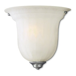 Dolan Designs Lighting - Large Single-Light Sconce - 227-09 - This sconce features an alabaster glass shade, which provides diffused illumination perfect for a bathroom, bedroom or hallway. The elongated bell-shaped shade has a scalloped pattern, which adds depth and dimension, and the satin nickel finish goes with a variety of color schemes. Takes (1) 60-watt incandescent A19 bulb(s). Bulb(s) sold separately. UL listed. Dry location rated.