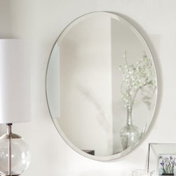 Odelia Oval Bevel Frameless Wall Mirror - 22W x 28H in. - Add depth size and interest to your smaller rooms with the Odelia Oval Bevel Frameless Wall Mirror. With its classic oval shape and 1-inch bevel this mirror looks great in bathrooms and guest bedrooms. The 1-inch bevel along the edge adds a contemporary look that goes great with any decor. Its sturdy .19-inch thick glass and metal construction with double coated silver backing that has seamed edges makes this mirror strong and durable. The mirror measures 22W x .5D x 28H inches and comes ready to hang with mounting hardware. You can hang this mirror vertically or horizontally.About Decor Wonderland of USDecor Wonderland US sells a variety of living room and bedroom furniture mirrors lamps home office necessities and decorative accessories. Decor Wonderland strives to add variety to their selection so that every home is beautifully and perfectly decorated to suit their customer's unique tastes.