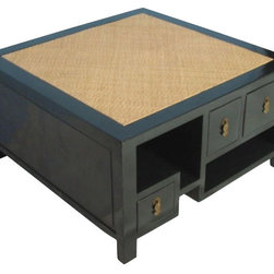 Square Rattan Top Coffee Table - The coffee table featured here has a rattan top, smooth and lustrous black lacquer finished sides, and multi-purpose storage space. With its Asian flair, this piece is sure to make an impression.