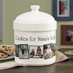 """Exposures - Personalized Photo Cookie Jar - Overview """"Put a batch of fresh-baked cookies inside this personalized photo cookie jar, and you've created the perfect custom gift. Get a custom photo cookie jar for yourself, so everyone in the house knows where to go for your latest baked treats. Upload your favorite photos and we'll transfer them onto the cookie jar along with your special message.  Features:  White ceramic personalized cookie jar Photos available in B&W, color or sepia Five photos Silicon lid seal keeps cookies fresh Hand wipe with damp cloth, not dishwasher safe """" Personalization   Personalize up to 1 line, 25 characters per line No returns on personalized items unless the item is damaged or defective  Specifications   23"""" circumference, 10 1/4"""" H x 7 1/4"""" diameter"""