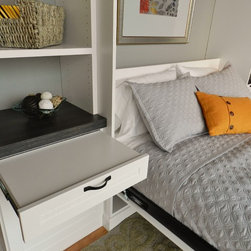 Showroom Wall Bed - Pull out tables are instant night stands for guest to leave their things.  This model includes a storage box to hold pillows while the bed is upright.