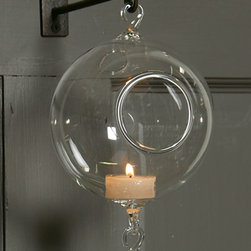 Double Hook Hanging Bubble - 5 in - Clear - Loop-shaped, integrated hooks at both top and bottom give endless freedom in creating decorative chains with the Double Hook Hanging Bubble.� A simple sphere of clear glass with one side open, the bubble makes for a tealight holder with an airy, delicate fantasy look and also offers a perfect place to plant a small, whimsical terrarium.� This decorative staple is easy to style for formal or casual occasions.