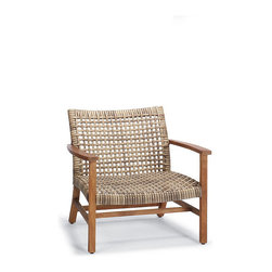 "Frontgate - Isola Outdoor Lounge Chair, Patio Furniture - With a breathable open weave, our Isola Lounge Chair is the perfect fit for arid and coastal climates alike. Generously proportioned seating features a solid premium teak frame wrapped in 3/4""-wide bands of driftwood-hued, all-weather wicker, widely woven for visual and tangible lightness. The chair's curved and rounded seat and back comfortably cradle you and each of your guests.Part of the Isola Collection. Handwoven premium resin wicker . Sustainably harvested teak is kiln dried to eliminate expansion and shrinkage . Teak will adopt a silvery patina over time . All-weather wicker has a driftwood-hued finish . Complements our Cassara Collection"