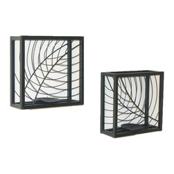 Danya B. - Set of Two Black Metal Shadow Box Candleholders - Reflect the natural world with style and structure in your home with this set of two candleholder shadow boxes with leaf wire accents. The lovely lines of the leaves create a profile in front of the tealight holders, and look amazing when illuminated by the candles' glow. They'd make a great addition to your side table, nightstand, or even hung on your wall.