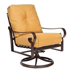 Woodard - Woodard Belden Cushion Swivel Rocking Lounge Chair - The Belden aluminum outdoor patio furniture collection completes the trio of Belden offerings from Woodard. As usual no apologies are necessary for this stunning collection of 24 items. Sharing its hand formed cast aluminum styling heritage with the Belden sling and Belden padded sling collection the Belden cushion collection is considered by some to be the pinnacle of Woodard's outdoor patio furniture products. Woodard's skilled artisans have outdone themselves in creating designer-class frame detail that soothes the eye while providing strength and durability.The Belden cushion aluminum outdoor patio furniture collection includes all the outdoor living outdoor patio furniture and dining furnishing options that you are considering for your home your retreat at the shore or your mountain chalet. The rust-resistant powder coated frame finishes can take whatever weather Mother Nature is in the mood to share and the cushions trims and chair ties are available in a wealth of attractive standard and designer fabric grades in solids stripes textures and patterns.The name Woodard Furniture has been synonymous with fine outdoor and patio furniture since the 1930s continuing the company�s furniture craftsmanship dating back over 140 years. Woodard began producing hand-made wrought iron furniture which led the company into cast and tubular aluminum furniture production over the years.� Most recently Woodard patio furniture launched its entry into the all-weather wicker furniture market with All Seasons which is expertly crafted and woven using synthetic wicker supported by an aluminum frame.� The company is widely known for durable beautiful designs that provide attractive and comfortable outdoor living environments.� Its hand-crafted technique used to create the intricate design patterns on its wrought iron furniture have been handed down from generation to generation -- a hallmark of quality unmatched in the fur