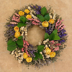 Frontgate - Spring Floral Wreath - Crafted from a mix of fresh and air-dried materials. Designed for indoor display. If displayed outdoors, hang in a covered area, away from direct sunlight. Greet guests with a delectable display of herbs, foliage, and flowers. Our classic wreath starts with a base of fresh salal leaves, structured with a wire frame. Dried gatherings of marjoram, sage, three colors of larkspur, yarrow, and strawflower create an arrangement ideal for any room, and any season.. . .
