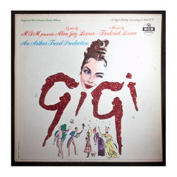 """Glittered Gigi Album - Glittered record album. Album is framed in a black 12x12"""" square frame with front and back cover and clips holding the record in place on the back. Album covers are original vintage covers."""
