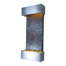 Bluworld - Medium Nojoqui Falls Lightweight Slate Fountain - Stainless Steel - This smaller lightweight version of the original Large Nojoqui Falls wall fountain is named after the beautiful 164 foot tall Nojoqui Falls waterfall, located in central California where the Water Wonders line was originated. These water fountains are a truly unique, engaging and an elegant addition to any indoor space. Redesigned, the Medium Nojoqui Falls fountain includes long-lasting super bright white LED lights rated for over 10,000 hours of use and an ergonomic finger slide remote control to easily dim or brighten the LED lights or turn them on and off. This water fountain glistens as water sheets over the genuine multi-color Indian Rajah Slate flowing past polished river rock creating a soothing sound and beautiful focal point for any room. This fountain is engineered with Bluworld's clog-free, splash-free design and features the Water Wonders NSI�� genuine light weight Slate. Installation is super easy with the lightweight nature of the NSI�� slate panels. Simply hang on the wall per the instructions.This water fountain can be customized with your logo. Etched and hand-painted logos start at only $395.00. Contact our sales department for more information at 1-888-499-5433.The Medium Nojoqui Falls fountain is the perfect size to hang on just about any wall, and it will instantly raise the level of class in any living room, foyer, office or lobby. These indoor water falls come with a choice of four finishes: Standard colors; Copper Vein and Black Onyx and premium finishes; Copper Patina,or Brushed Stainless Steel.Water Wonders NSI�� Light Weight Slate��- Water fountains made with our NSI�� Light Weight Slate use our patent pending technology which sheers a layer of genuine Indian Raja Slate and fuses it to composite material with the same chipped edge technique as slab slate. They are indistinguishable from a thick slab of slate. All the beauty is retained and the weight is reduced by over 90% making it easier to hang a wall fountain. Once it's installed, your only concerns are setting the flow rate and turning on the accent light with your handy remote. Please note that these units are handmade and measurements may vary slightly. Texture and color of aged rustic copper, metals and slate may also vary slightly with each fountain.