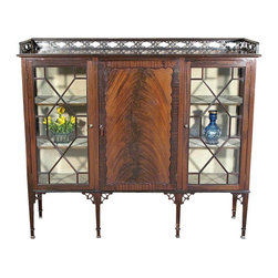 Antiques - Antique English Flame Mahogany Curio Display Cabinet w/ Closed Bookcase - This is a gorgeous flame mahogany curio cabinet with a closed bookcase. It has a beautiful gallery on its top surface and it features 2 curio cabinets that have 6 shelves lined with fabric. They have beautiful *astragal wood glazed glass doors. The bookcase on the center has 3 shelves, a paneled door that has a lovely frame and it has a lock mechanism with 1 key present. The shaped legs have attractive pierced brackets. The fabric on the shelves shows some wear and stains, the bookcase door is slightly warped but operates well, the gallery on top has wood imperfections and there are missing pieces on the leg brackets and ornamentsotherwise as shown  it is overall in very good cosmetic and structural condition and it is strong and sturdy. This beautiful furniture will be welcome in any room you choose to use it in since it blends in well with many decors.What is astragal (wood or lead) glazing?  As it pertains to later period furniture, it is a method of securing glass to the straight, semi-circular, or shaped moldings found on glass doors and windows of furniture. On newer reproduction furniture, the astragal molding may set atop the glass to give the appearance of glazing where on older English furniture, it is not uncommon for each piece of glass to be cut to shape and glazed into the molding.Other Dimensions (In inches)Top Surface 49.25H x 57W x 15.25DLeft/Right Curio Shelves1- 11.75H x 17W x 12.75D2- 10.75H x 17W x 12.75D3- 10.5H x 17W x 12.75DBookcase Shelves1- 11.75H x 20.75W x 13D2- 10.75H x 20.75W x 13D3- 10.5H x 20.75W x 13D