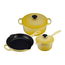 Le Creuset - Le Creuset 5 pc. Signature Cookware Set - Soleil - MS12051-1M - Shop for Cookware Sets from Hayneedle.com! When you have the Le Creuset 5 pc. Signature Cookware Set - Soleil you'll be up with the sun and cooking with abandon. This starter set is the color of sunshine and just as powerful. You get a three-egg omelet-sized skillet round French oven with lid and a precision pour saucepan with lid. All are made of even-heating cast iron ergonomic handles and an advanced enamel that won't chip. You can use these beauties on any heat source and they're even dishwasher-friendly. A generous gift for the newlyweds or yourself!About Le Creuset of America Inc.From its cast iron cookware to its teakettles and mugs Le Creuset is a global standard of inimitable color and quality. Founded in 1925 in the northern French town of Fresnoy-Le-Grand Le Creuset still produces enameled cast iron in its original foundry. Its signature color Flame was modeled after the intense orange hue of molten cast iron within a cauldron (or creuset in French) and has been a Le Creuset bestseller from the company's first year to the present day.Though best known for its vibrantly colored cookware and original inventions such as the Dutch oven Le Creuset has also forged a name as a creator of stoneware mugs and enamel-coated stainless steel teakettles. The style and performance of Le Creuset's Cafe Collection and tea accessories are rooted in classic French cookware: bold colors cylindrical loop handles unmatched thermal resistance and heat distribution and of course the iconic Le Creuset three-ring accent. Through its consistent qualities of authenticity originality and innovation Le Creuset maintains a connection to both heritage and modernity.