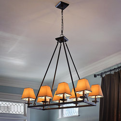 None - Indoor 8-light Bronze Chandelier - Light up any room with the clean lines of this indoor oil-rubbed bronze chandelier. It features eight lights to fully illuminate several different room sizes. The 72-inch chain allows for hanging at several heights to suit your needs.