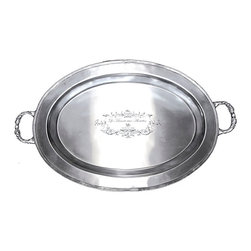 Brasserie Pewter Oval Tray - Your vignettes become spectacular on the Brasserie Pewter Oval Tray, a richly-engraved and appealingly traditional piece which is equipped with handles at either end for easy serving and for simple display between uses. The brushed pewter finish adds a handsome sheen to a shape constructed in layers of rim and center for a distinctive old-world look in your home.