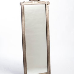 Provence Long Mirror - Silver Leaf - Designed as an entryway piece and beautiful when reflecting the light of a window, the Provence Long Mirror in Silver Leaf visually expands a room while beautifully illuminating the space, both with intensified indirect light and with the glamor of rubbed silver gilding.� A crowning shell motif honors old-world styles in the architectural frame of this gracious vertical wall mirror.