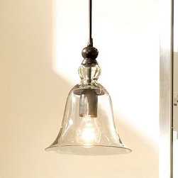 Rustic Glass Pendant | Pottery Barn - These pendants are made of blown glass and brass with a hand-rubbed bronze finish. Three of these would look great over a kitchen bar or kitchen table— very cool.