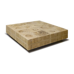 Manteiga Coffee Table - This puzzle-like cocktail table is made using a labor intensive technique in which each piece fits perfectly to allow a smooth table top. Each cross-cut piece of wood is selected to show details of the rich wood grains. Wood options include vinhático, teak, and mango.