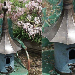 Large Metal Birdhouse - A charming touch for your home or yard. This large Victorian style Birdhouse is the perfect touch to delight all your feathered (and non-feathered) friends. The generous size provides plenty of room for a growing family.