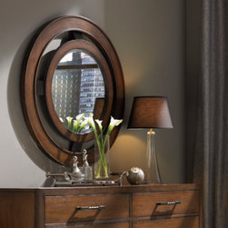 Lexington Home Brands - Radius Mirror - The concentric rings are anchored at the points of the compass with graphite metal support brackets, angled outward to gently project the framed mirror into the room.