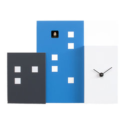Progetti - Walls Cucu 2275 Blue/White Wall Clock - Walls Cuckoo is a wall or table cuckoo clock, made of painted wood, which, thanks to three volumes of different heights and depths, creates the skyline of a modern city built of buildings and skyscrapers. Unlike the profiles of average towns, Walls Cuckoo is a linear and material object which recreates, in its compactness, the third dimension. Battery quartz movement.