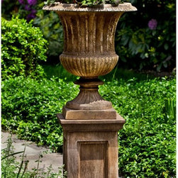 Campania International - Campania International Smithsonian Classical Urn Planter with Barnett Pedestal - - Shop for Planters and Pottery from Hayneedle.com! Recreate a masterpiece by adding the Campania International Smithsonian Classical Urn Planter with Barnett Pedestal to your landscape design. This set is made of lightweight and durable cast stone that comes in a variety of aged finish options. Season after season this graceful urn and its classic pedestal base will bring joy to your landscape design. Campania Cast Stone: The ProcessThe creation of Campania's cast stone pieces begins and ends by hand. From the creation of an original design making of a mold pouring the cast stone application of the patina to the final packing of an order the process is both technical and artistic. As many as 30 pairs of hands are involved in the creation of each Campania piece in a labor intensive 15 step process.The process begins either with the creation of an original copyrighted design by Campania's artisans or an antique original. Antique originals will often require some restoration work which is also done in-house by expert craftsmen. Campania's mold making department will then begin a multi-step process to create a production mold which will properly replicate the detail and texture of the original piece. Depending on its size and complexity a mold can take as long as three months to complete. Campania creates in excess of 700 molds per year.After a mold is completed it is moved to the production area where a team individually hand pours the liquid cast stone mixture into the mold and employs special techniques to remove air bubbles. Campania carefully monitors the PSI of every piece. PSI (pounds per square inch) measures the strength of every piece to ensure durability. The PSI of Campania pieces is currently engineered at approximately 7500 for optimum strength. Each piece is air-dried and then de-molded by hand. After an internal quality check pieces are sent to a finishing department where seams are ground and any air holes caused by the pouring process are filled and smoothed. Pieces are then placed on a pallet for stocking in the warehouse.All Campania pieces are produced and stocked in natural cast stone. When a customer's order is placed pieces are pulled and unless a piece is requested in natural cast stone it is finished in a unique patinas. All patinas are applied by hand in a multi-step process; some patinas require three separate color applications. A finisher's skill in applying the patina and wiping away any excess to highlight detail requires not only technical skill but also true artistic sensibility. Every Campania piece becomes a unique and original work of garden art as a result.After the patina is dry the piece is then quality inspected. All pieces of a customer's order are batched and checked for completeness. A two-person packing team will then pack the order by hand into gaylord boxes on pallets. The packing material used is excelsior a natural wood product that has no chemical additives and may be recycled as display material repacking customer orders mulch or even bedding for animals. This exhaustive process ensures that Campania will remain a popular and beloved choice when it comes to garden decor.About Campania InternationalEstablished in 1984 Campania International's reputation has been built on quality original products and service. Originally selling terra cotta planters Campania soon began to research and develop the design and manufacture of cast stone garden planters and ornaments. Campania is also an importer and wholesaler of garden products including polyethylene terra cotta glazed pottery cast iron and fiberglass planters as well as classic garden structures fountains and cast resin statuary.