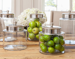 Margaret Canister - Small - With a classic, sophisticated shape, our Small Margaret Canister, which measures 9″ x 10″, makes the perfect pantry jar. In the kitchen, fill it with dried goods such as pasta and rice, or display it around your home as a decorative accessory stocked with colorful treats like hard candy or citrus. Shop our Large Margaret Canister (pictured) for the perfect pair.