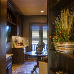 Bella Vita Custom Homes - On French doors 3 1/2 louvers clear view Knotty Alder stained shutter with a cut out  cat walk of the Secret room.  Photo taken by Four Walls Photography