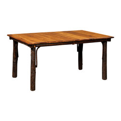 Chelsea Home Furniture - Chelsea Home Amos Table - This solid Maple Amos Table compliments any log cabin or rustic decor with ease. The table legs are made of strong and resilient Hickory twigs. With varied natural markings in the warm-toned table top with natural stain, this will cozy up any kitchen or dining room. Chelsea Home Furniture proudly offers handcrafted American made heirloom quality furniture, custom made for you. What makes heirloom quality furniture? It's knowing how to turn a house into a home. It's clean lines, ingenuity and impeccable construction derived from solid woods, not veneers or printed finishes over composites or wood products _ the best nature has to offer. It's creating memories. It's ensuring the furniture you buy today will still be the same 100 years from now! Every piece of furniture in our collection is built by expert furniture artisans with a standard of superiority that is unmatched by mass-produced composite materials imported from Asia or produced domestically. This rare standard is evident through our use of the finest materials available, such as locally grown hardwoods of many varieties, and pine, which make our products durable and long lasting. Many pieces are signed by the craftsman that produces them, as these artisans are proud of the work they do! These American made pieces are built with mastery, using mortise-and-tenon joints that have been used by woodworkers for thousands of years. In addition, our craftsmen use tongue-in-groove construction, and screws instead of nails during assembly and dovetailing _both painstaking techniques that are hard to come by in today's marketplace. And with a wide array of stains available, you can create an original piece of furniture that not only matches your living space, but your personality. So adorn your home with a piece of furniture that will be future history, an investment that will last a lifetime.