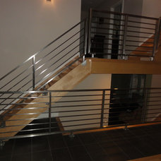 Contemporary Staircase by Capozzoli Metalworks