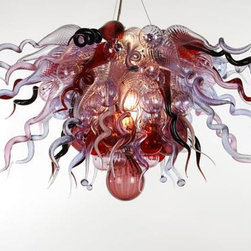 Red Fern Glass - Blown Glass Chandelier 510 - A romantic chandelier of hand blown-glass in Rose, Violet, Lavender, Amethyst and Red. The form mimics the shape of a traditional crystal chandelier, but this shallow half orb described by curly spikes, and knobby curls is far from traditional. A few Chandeliers are also available without lighting, call for pricing.  These exquisite designs are very diverse, and can be custom made to perfect any project.        Handcrafted in USA! Note- This fixture ships in 4-6 weeks.  Note- Colors shape and size can all be modified specifically for your design needs. See image 2 for color chart. Please call for pricing and more details.             Please note that the price listed pertains to a fixture that will appear very similar to the light shown in the featured photograph and as outlined in the accompanying description.  Virtually all of our artisan crafted fixtures can be customized regarding size, shape, and / or color(s).  Please call for details.