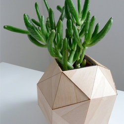 Wooden Geometric Vase by Urban Analog - This origami wooden vase is the perfect addition to your Zen garden. In case you don't feel the need to install a whole Zen garden, it would be beautiful in a natural interior.