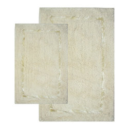 None - Greenville Vanilla 2-Piece Bath Rug Set - Enhance any bathroom decor with this plush, off-white, cotton bath mat set. Featuring a neutral vanilla shade with a shiny same-shade accent border, this two-piece set is made of a machine-washable cotton rayon blend with spray latex backing.