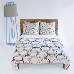 DENY Designs - DENY Designs Rachael Taylor Circles Duvet Cover Multicolor - 13251-DUWKIN - Shop for Duvets from Hayneedle.com! Beautiful and easy to care for the DENY Designs Rachael Taylor Circles Duvet Cover is a wonderful addition to any bedroom. Featuring an easy snap closure and a circle pattern in your choice of colors this duvet cover is custom-printed for your order using a 6-color dye process.About DENY DesignsDenver Colorado based DENY Designs is a modern home furnishings company that believes in doing things differently. DENY encourages customers to make a personal statement with personal images or by selecting from the extensive gallery. The coolest part is that each purchase gives the super talented artists part of the proceeds. That allows DENY to support art communities all over the world while also spreading the creative love! Each DENY piece is custom created as it's ordered instead of being held in a warehouse. A dye printing process is used to ensure colorfastness and durability that make these true heirloom pieces. From custom furniture pieces to textiles everything made is unique and distinctively DENY.