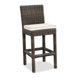 Thos. Baker - Wicker Outdoor Counter Stool | Hampton Collection - Oversized seating in all-weather wicker with a slightly weathered look inspired by classic whitewashed country home styles. Premium, dyed-through resin wicker with an extra large diameter profile and elegant ocean gray finish. Powder-coated aluminum subframe and brushed aluminum feet.Plush Sunbrella cushion sets included where applicable. Choose quick ship in khaki with cocoa piping, stone green or choose from our made-to-order fabric options.Made-to-order cushion sales are final and ship in 2-3 weeks.