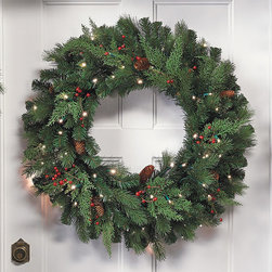 """Frontgate - 24"""" White Pine Cordless Christmas Wreath - Boughs and berries perfectly mimic nature. Superbright, 5mm LED bulbs are energy efficient and long lasting. Convenient 6-hour timer. Optional manual switch located on the weatherproof battery box. Operates on D batteries (not included). Watch the Video Wispy cedar and Douglas fir branches and berries, along with pinecones and bright LED lights make our Winter Pine Cordless wreaths and garland truly shine. This lush greenery can be easily programmed to glow at the same time, every day of the week.  .  .  .  .  . To maximize fullness, greenery will need to be shaped. Bows sold separately."""