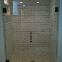ATM Mirror and Glass - Frameless Shower Enclosures - Fully frameless glass shower enclosure.  Low iron glass was used here to complement the white tile used.