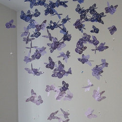 Chandelier Monarch Butterfly Mobile, Purple by Dragon on the Fly - This ombre purple chandelier doesn't give off light, but man, is it lovely? It would make such a statement in front of a window or over a crib. You can also find DIY instructions on my blog.