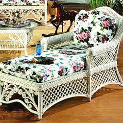 Spice Island Wicker - Wicker Chaise Lounge with Cushions (Solar Kiwi - All Weather) - Fabric: Solar Kiwi (All Weather)Relax in supreme comfort while resting easy in the knowledge that you possess the most perfectly comfortable and exquisitely stylish chaise lounge on the market.  Sure, you can't leave such a fine wicker frame chaise lounge out in the rain, but would you want to relax out there anyway?  That's what the designers thought.  The charm of a chaise includes a sense of refinement and timeless style.  Stylistic botanicals at foot complement the open diamond weave on sides and back. * Solid Wicker Construction. White Finish. For indoor, or covered patio use only. Cushions included. 70 in. W x 27 in. D x 39 in. H