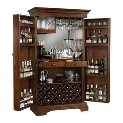 Howard Miller - Howard Miller Sonoma Hide A Home Bar in Americana Cherry - Howard Miller - Home Bars - 695064 - About This Product: Classically styled in an almost Mission-themed armoire style with a broadly molded crown and base and full-height doors the Sonoma will fit seamlessly into a traditional decor dining area that has the space sufficient to accommodate it. Upon opening the doors one is presented with a wealth of cocktail storage that is truly incomparable. Each door interior features four fixed shelves while a 22 bottle lower wine rack rests below another deep shelf and two pull drawers for any and all accessories you deem necessary. A spacious serving shelf is backed by a lovely mirrored surface and a top corner shelf and roof stemware rack provide safe glass retention. A rich Americana Cherry finish completes the resounding appeal of the supremely well-appointed Sonoma Hide A Bar. This traditional Hide A Bar quite simply represents the finest in concealing bar cabinetry.